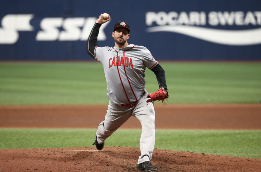 SEOUL, SOUTH KOREA - NOVEMBER 06: Phillippe Aumont #17 of Canada pitches in the bottom of seventh inning during the WBSC Premier 12 Opening Game Group C game between Cuba and Canada at the Gocheok Sky Dome on November 06, 2019 in Seoul, South Korea. (Photo by Chung Sung-Jun/Getty Images)