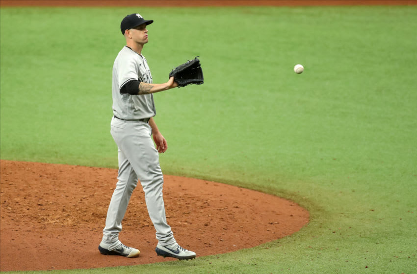 ST. PETERSBURG, FL - AUGUST 9: James Paxton #65 of the New York Yankees waits for a new ball after giving up a home run to Michael Brosseau #43 of the Tampa Bay Rays during the seventh inning of a baseball game at Tropicana Field on August 9, 2020 in St. Petersburg, Florida. (Photo by Mike Carlson/Getty Images)