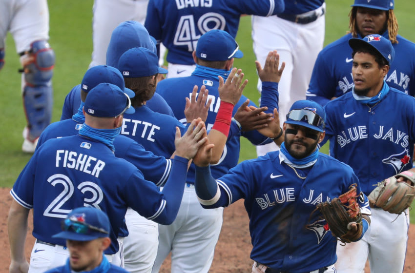 BUFFALO, NY - SEPTEMBER 13: Jonathan Villar #20 of the Toronto Blue Jays leads the celebration after the Blue Jays 7-3 victory over the New York Mets at Sahlen Field on September 13, 2020 in Buffalo, New York. (Photo by Nicholas T. LoVerde/Getty Images)