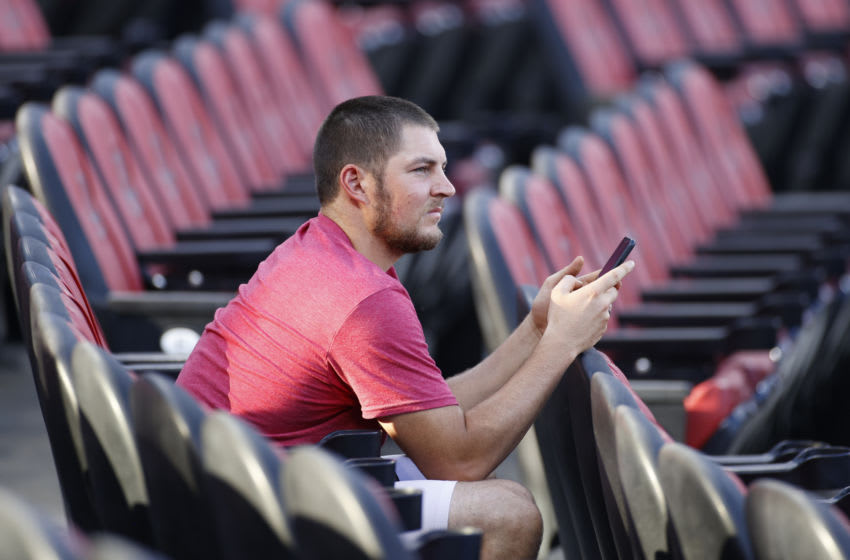 CINCINNATI, OH - JULY 18: Cincinnati Reds pitcher Trevor Bauer looks on while on his cell phone during a team scrimmage at Great American Ball Park on July 18, 2020 in Cincinnati, Ohio. (Photo by Joe Robbins/Getty Images)
