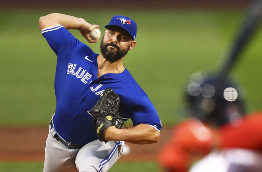 BOSTON, MA - AUGUST 07: Tanner Roark #14 of the Toronto Blue Jays pitches in the first inning of a game against the Boston Red Sox at Fenway Park on August 7, 2020 in Boston, Massachusetts. (Photo by Adam Glanzman/Getty Images)