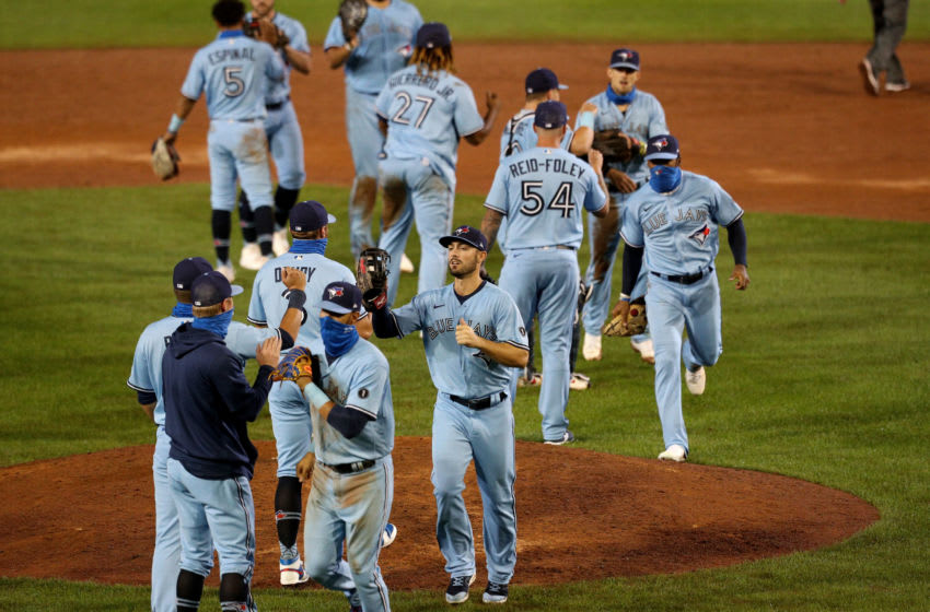 BUFFALO, NEW YORK - AUGUST 26: The Toronto Blue Jays celebrate after defeating the Boston Red Sox 9-1 at Sahlen Field on August 26, 2020 in Buffalo, New York. The Blue Jays are the home team and are playing their home games in Buffalo due to the Canadian government's policy on the coronavirus (COVID-19). (Photo by Bryan M. Bennett/Getty Images)