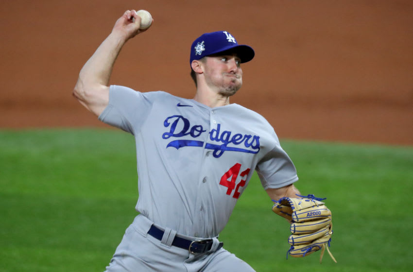 """ARLINGTON, TEXAS - AUGUST 29: Ross Stripling #42 of the Los Angeles Dodgers pitches against the Texas Rangers in the bottom of the first inning at Globe Life Field on August 29, 2020 in Arlington, Texas. All players are wearing #42 in honor of Jackie Robinson Day. The day honoring Jackie Robinson, traditionally held on April 15, was rescheduled due to the COVID-19 pandemic."""" (Photo by Tom Pennington/Getty Images)"""