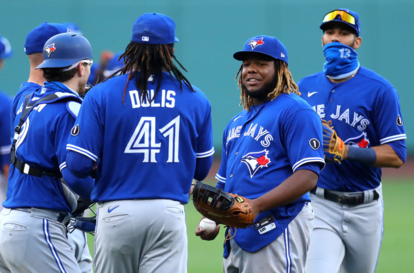 BOSTON, MASSACHUSETTS - SEPTEMBER 06: Rafael Dolis #41 and Vladimir Guerrero Jr. #27 of the Toronto Blue Jays celebrate after the Blue Jays defeat the Boston Red Sox 10-8 at Fenway Park on September 06, 2020 in Boston, Massachusetts. (Photo by Maddie Meyer/Getty Images)