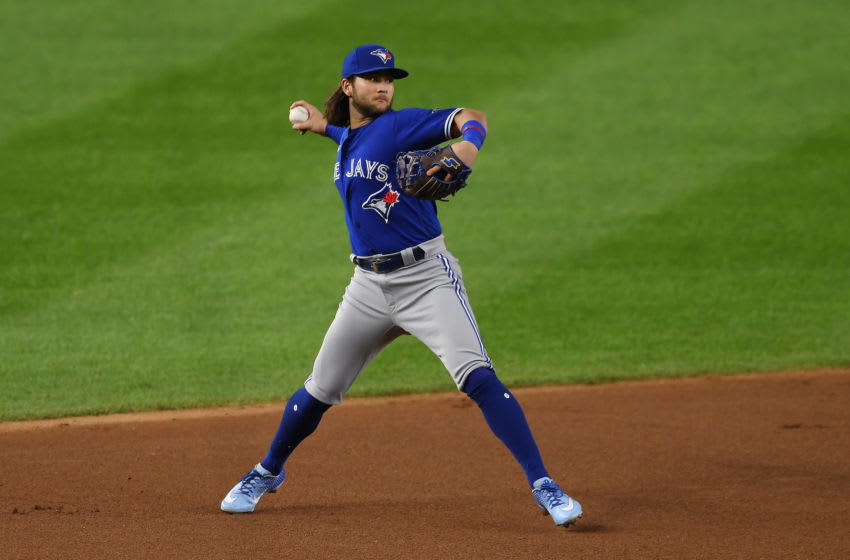 NEW YORK, NEW YORK - SEPTEMBER 15: Bo Bichette #11 of the Toronto Blue Jays throws to first during the first inning against the New York Yankees at Yankee Stadium on September 15, 2020 in the Bronx borough of New York City. (Photo by Sarah Stier/Getty Images)