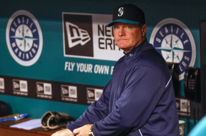 SEATTLE, WA - SEPTEMBER 27: Manager Eric Wedge #22 of the Seattle Mariners looks on from the dugout prior to the game against the Oakland Athletics at Safeco Field on September 27, 2013 in Seattle, Washington. Earlier in the day Wedge announced he would not be returning in 2014. (Photo by Otto Greule Jr/Getty Images)