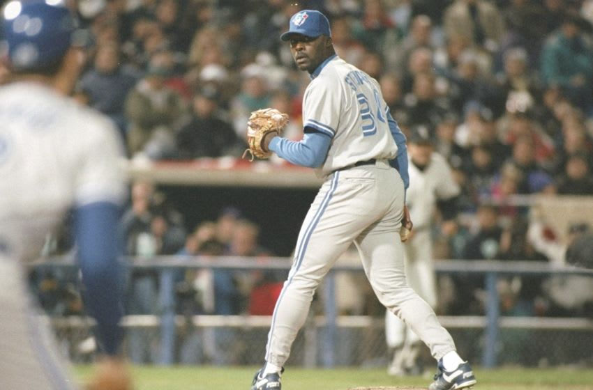 12 Oct 1993: Pitcher Dave Stewart of the Toronto Blue Jays watches a base runner during a playoff game against the Chicago White Sox at Comiskey Park in Chicago, Illinios. Mandatory Credit: Jonathan Daniel /Allsport