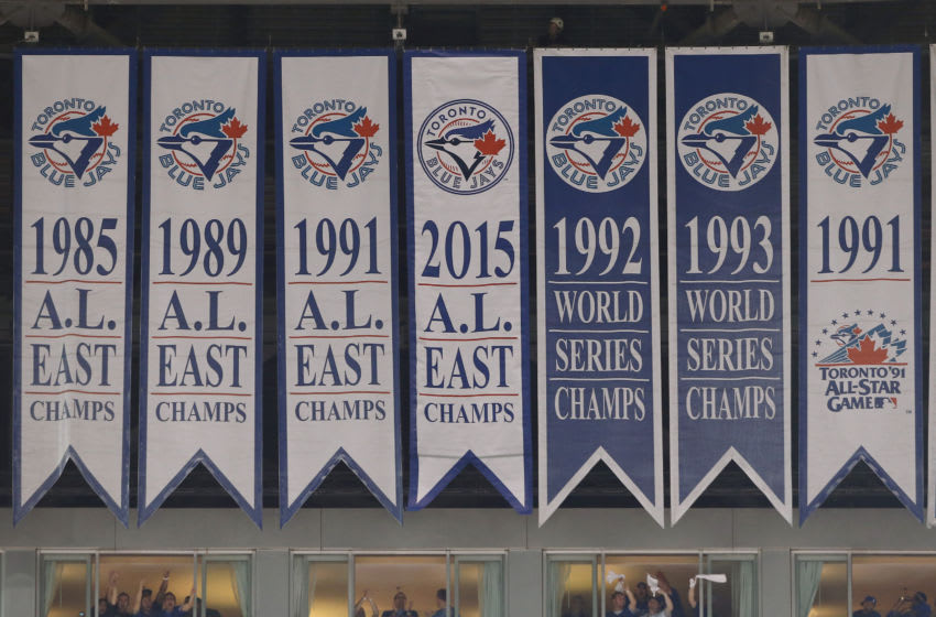 TORONTO, CANADA - OCTOBER 8: A new banner is unveiled above the jumbotron marking the Toronto Blue Jays division championship after winning the American League East title before the start of action against the Texas Rangers in Game One of the American League Division Series during the 2015 MLB Playoffs at Rogers Centre on October 8, 2015 in Toronto, Ontario, Canada. (Photo by Tom Szczerbowski/Getty Images)