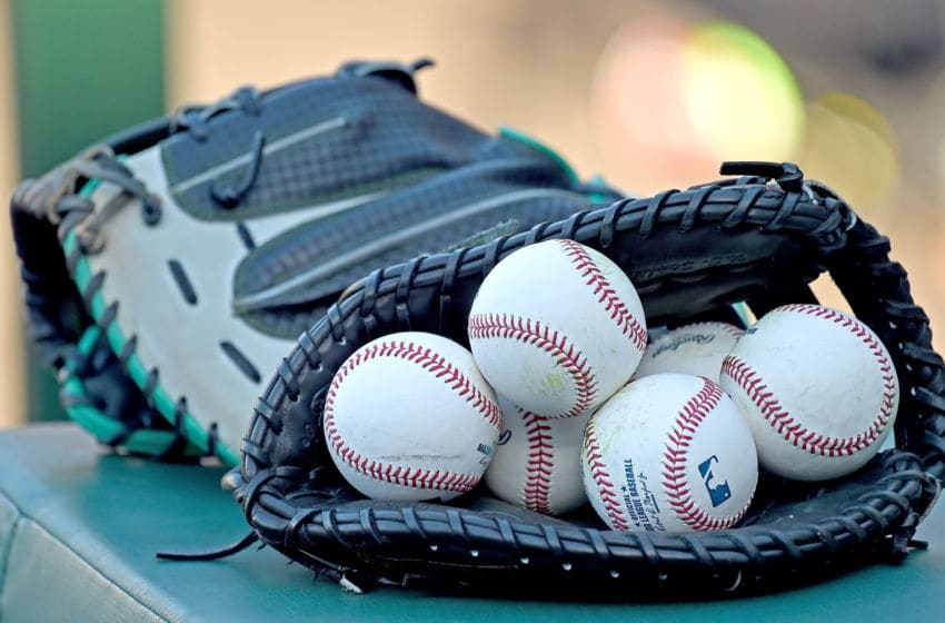 ANAHEIM, CA - AUGUST 16: Major league baseballs sit in a glove as the Seattle Mariners warm up before the game against the Los Angeles Angels at Angel Stadium of Anaheim on August 16, 2016 in Anaheim, California. (Photo by Jayne Kamin-Oncea/Getty Images)
