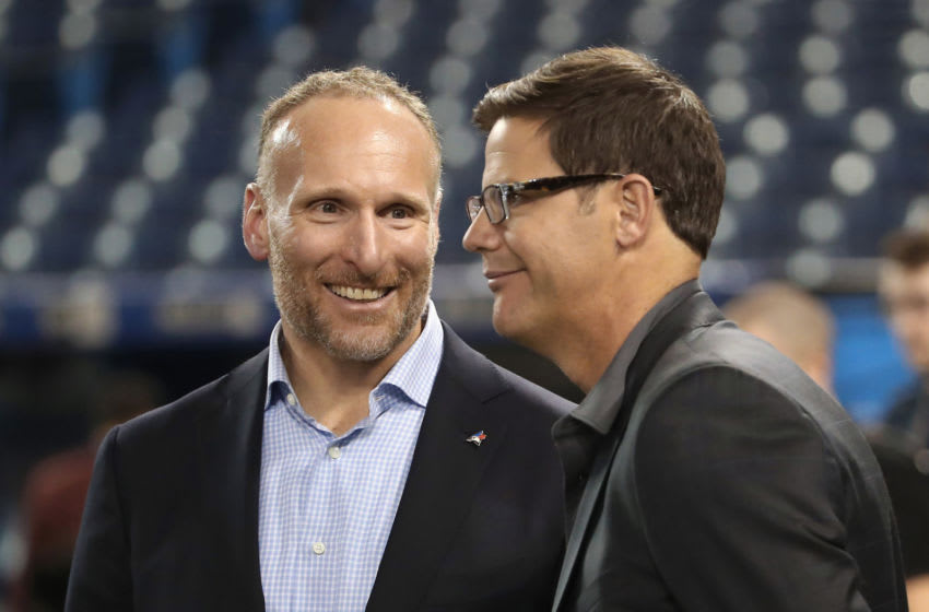 TORONTO, ON - APRIL 11: President and CEO Mark Shapiro of the Toronto Blue Jays talks to general manager Ross Atkins before the start of their home opener against the Milwaukee Brewers at Rogers Centre on April 11, 2017 in Toronto, Canada. (Photo by Tom Szczerbowski/Getty Images)