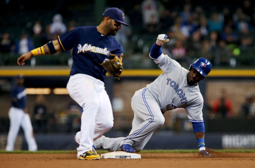 MILWAUKEE, WI - MAY 24: Dwight Smith Jr. #15 of the Toronto Blue Jays slides into second base for a double past Jonathan Villar #5 of the Milwaukee Brewers in the ninth inning at Miller Park on May 24, 2017 in Milwaukee, Wisconsin. (Photo by Dylan Buell/Getty Images)
