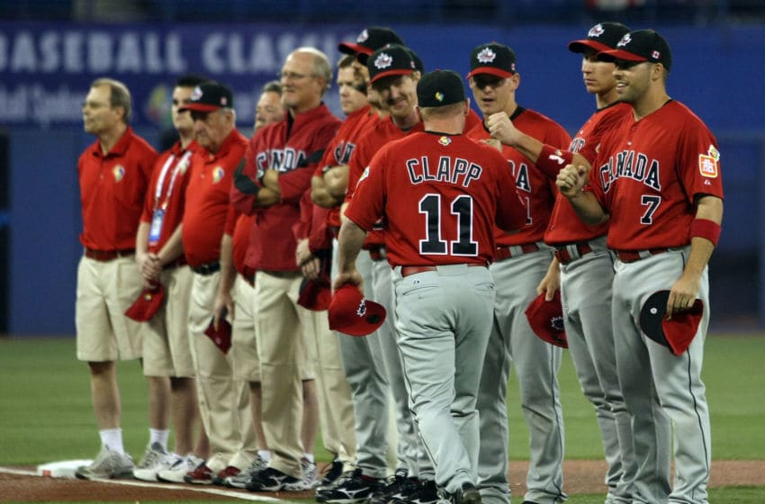 TORONTO, ON - MARCH 07: Stubby Clapp #11 of Canada greets his teammates during the 2009 World Baseball Classic Pool C match on March 7, 2009 at the Rogers Center in Toronto, Ontario, Canada. The USA defeated Canada 6-5. (Photo by Elsa/Getty Images)