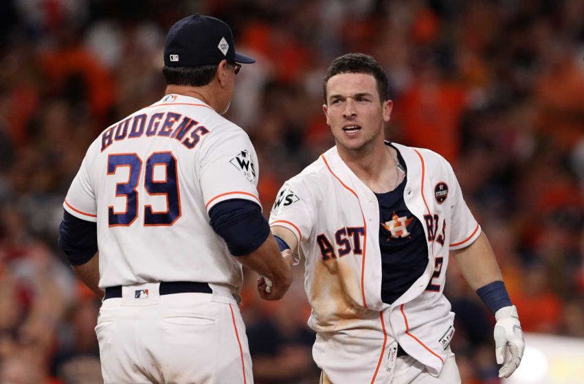 HOUSTON, TX - OCTOBER 30: Alex Bregman #2 of the Houston Astros celebrates with hitting coach Dave Hudgens #39 after defeating the Los Angeles Dodgers in the early morning hours during game five of the 2017 World Series at Minute Maid Park on October 30, 2017 in Houston, Texas. The Astros defeated the Dodgers 13-12. (Photo by Christian Petersen/Getty Images)