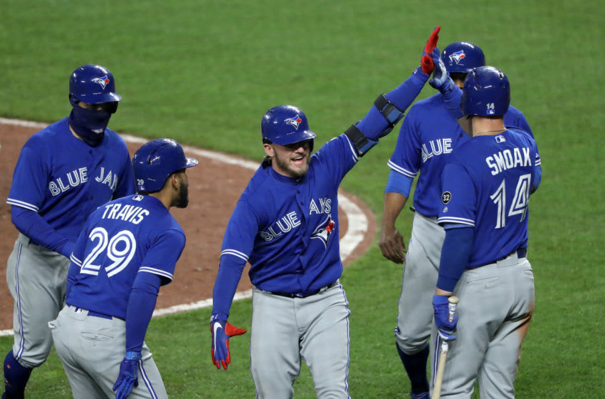 BALTIMORE, MD - APRIL 9: Josh Donaldson #20 of the Toronto Blue Jays celebrates after hitting a grand slam against the Baltimore Orioles in the eighth inning at Oriole Park at Camden Yards on April 9, 2018 in Baltimore, Maryland. (Photo by Rob Carr/Getty Images)