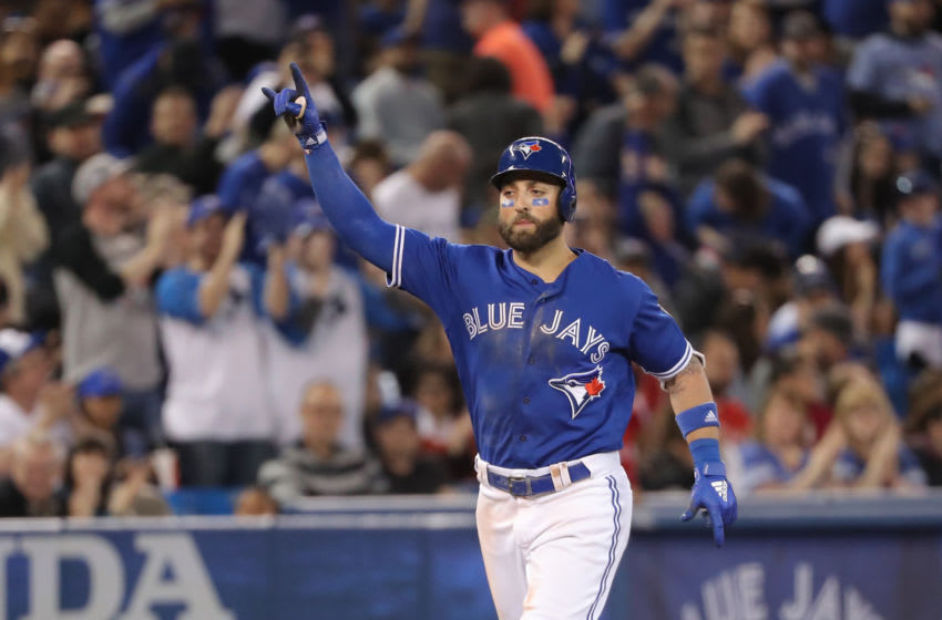 TORONTO, ON - APRIL 29: Kevin Pillar #11 of the Toronto Blue Jays celebrates after hitting a solo home run in the fourth inning during MLB game action against the Texas Rangers at Rogers Centre on April 29, 2018 in Toronto, Canada. (Photo by Tom Szczerbowski/Getty Images)