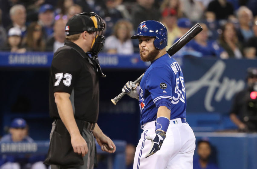 TORONTO, ON - MAY 18: Russell Martin #55 of the Toronto Blue Jays argues a called third strike call by home plate umpire Tripp Gibson #73 in the second inning during MLB game action against the Oakland Athletics at Rogers Centre on May 18, 2018 in Toronto, Canada. (Photo by Tom Szczerbowski/Getty Images)