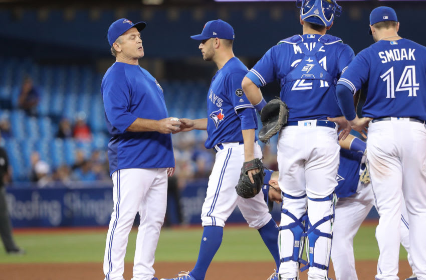 TORONTO, ON - MAY 18: Marco Estrada #25 of the Toronto Blue Jays exits the game as he is relieved by manager John Gibbons #5 in the seventh inning during MLB game action against the Oakland Athletics at Rogers Centre on May 18, 2018 in Toronto, Canada. (Photo by Tom Szczerbowski/Getty Images)
