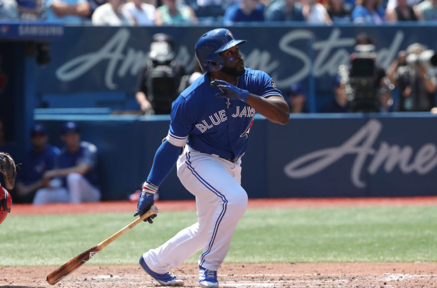 TORONTO, ON - MAY 24: Dwight Smith Jr. #27 of the Toronto Blue Jays hits a solo home run in the sixth inning during MLB game action against the Los Angeles Angels of Anaheim at Rogers Centre on May 24, 2018 in Toronto, Canada. (Photo by Tom Szczerbowski/Getty Images)