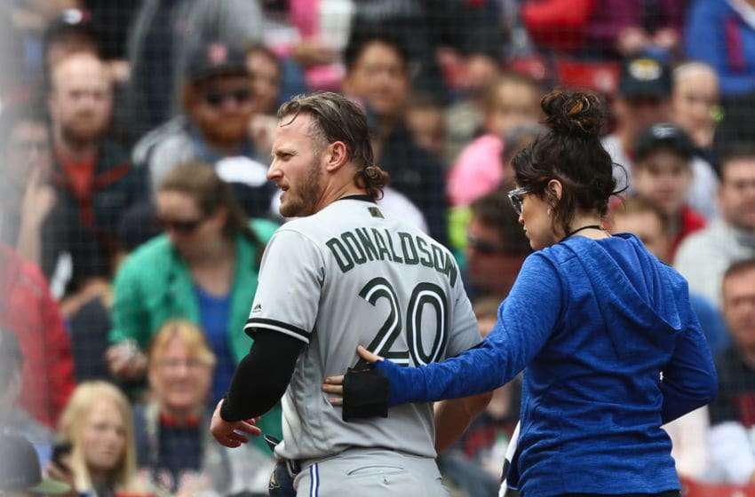 BOSTON, MA - MAY 28: Josh Donaldson #20 of the Toronto Blue Jays leaves the game and is replace by pinch runner Giovanny Urshela #3 of the Toronto Blue Jays in the top of the fifth inning of the game against the Boston Red Sox at Fenway Park on May 28, 2018 in Boston, Massachusetts. MLB Players across the league are wearing special uniforms to commemorate Memorial Day. (Photo by Omar Rawlings/Getty Images)