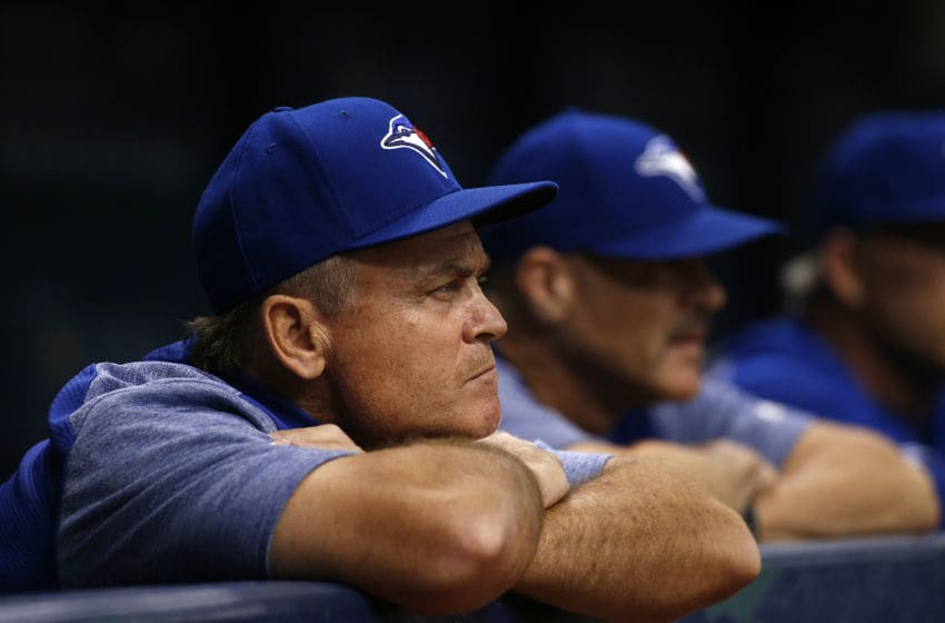 ST. PETERSBURG, FL - JUNE 11: Manager John Gibbons #5 of the Toronto Blue Jays looks on from the dugout during the third inning of a game against the Tampa Bay Rays on June 11, 2018 at Tropicana Field in St. Petersburg, Florida. (Photo by Brian Blanco/Getty Images)