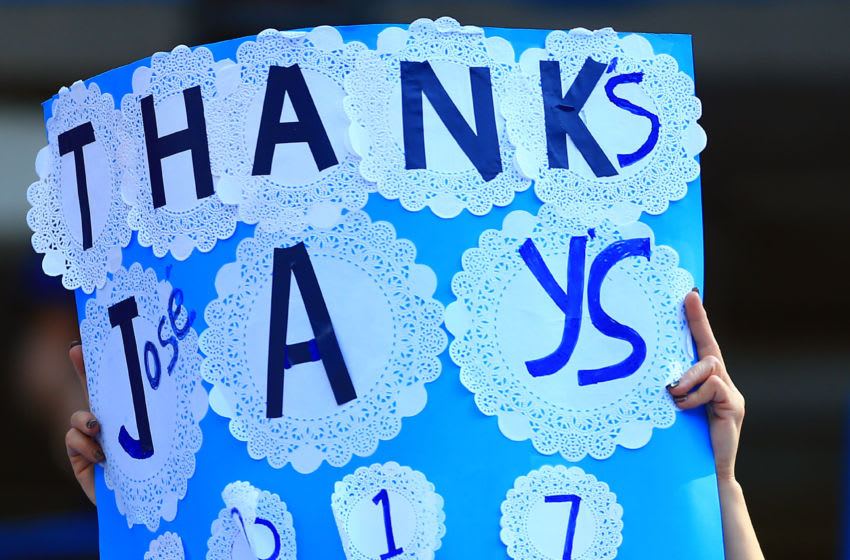 TORONTO, ON - SEPTEMBER 24: Fans show their appreciation with a sign for Jose Bautista