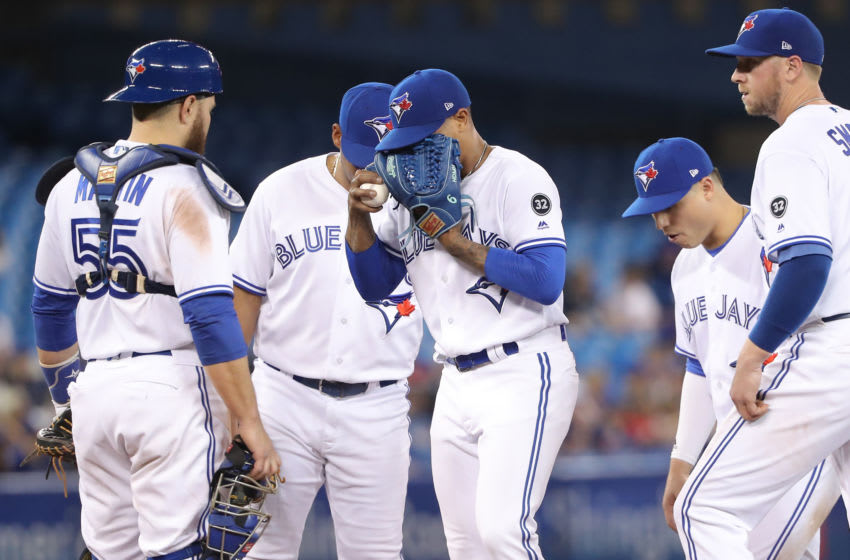 TORONTO, ON - APRIL 27: Marcus Stroman #6 of the Toronto Blue Jays reacts moments before being relieved after giving up a single in the sixth inning during MLB game action against the Texas Rangers at Rogers Centre on April 27, 2018 in Toronto, Canada. (Photo by Tom Szczerbowski/Getty Images)