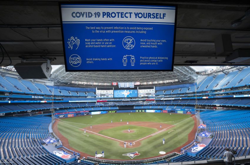 TORONTO, ON - JULY 09: A Covid-19 warning sign is seen over the diamond at Rogers Centre on July 9, 2020 in Toronto, Canada. (Photo by Mark Blinch/Getty Images)