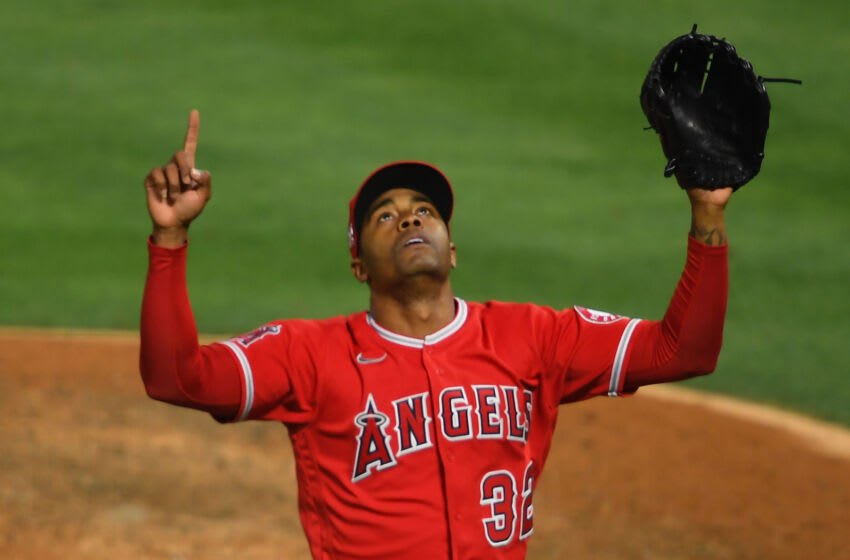 ANAHEIM, CA - JUNE 04: Raisel Iglesias #32 of the Los Angeles Angels celebrates after pitching out of a bases loaded, no outs jam in the eighth inning of the game against the Seattle Mariners at Angel Stadium of Anaheim on June 4, 2021 in Anaheim, California. (Photo by Jayne Kamin-Oncea/Getty Images)