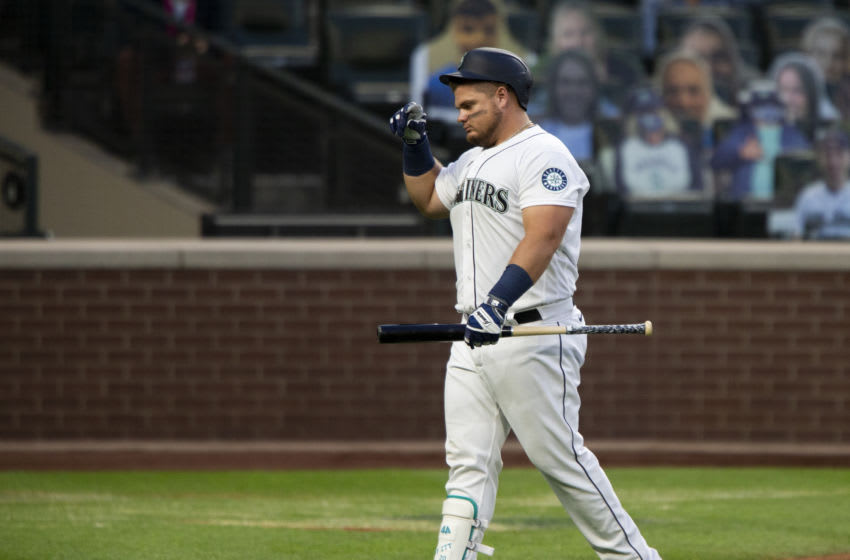 SEATTLE, WA - AUGUST 05: Daniel Vogelbach #20 of the Seattle Mariners walks back to the dugout after fouling out during the fifth inning against the Los Angeles Angels at T-Mobile Park on August 5, 2020 in Seattle, Washington. The Mariners beat the Angels 7-6. (Photo by Lindsey Wasson/Getty Images)