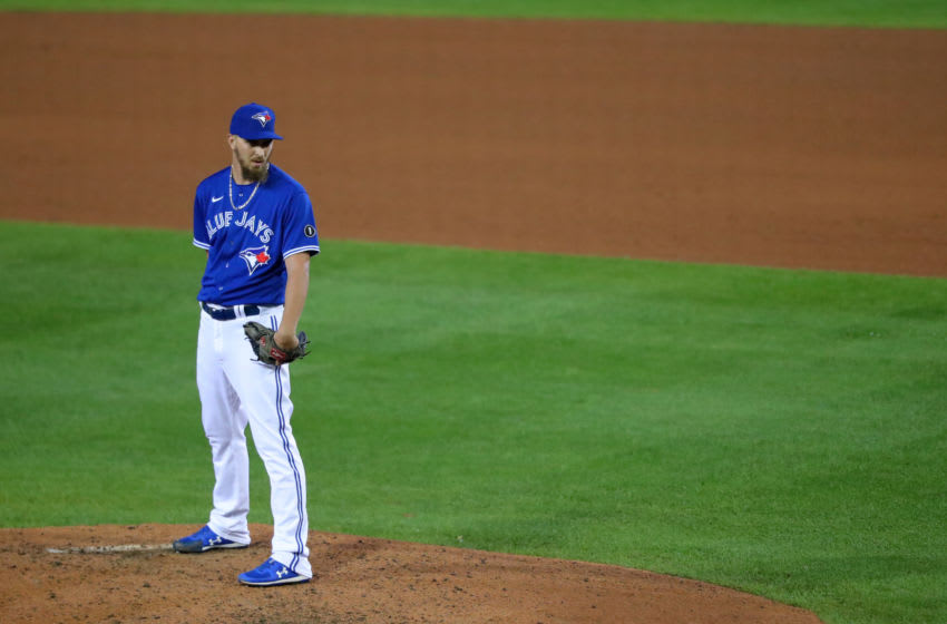 BUFFALO, NY - SEPTEMBER 23: A.J. Cole #36 of the Toronto Blue Jays looks to throw a pitch against the New York Yankees at Sahlen Field on September 23, 2020 in Buffalo, New York. The Blue Jays are the home team due to the Canadian government