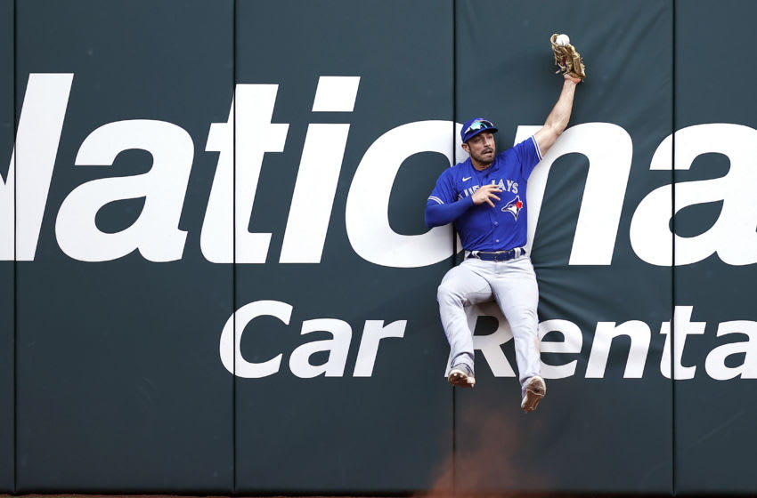 ARLINGTON, TEXAS - APRIL 05: Randal Grichuk #15 of the Toronto Blue Jays drops the ball at the wall on a RBI double hit by Brock Holt #16 of the Texas Rangers in the bottom of the ninth inning on Opening Day at Globe Life Field on April 05, 2021 in Arlington, Texas. (Photo by Tom Pennington/Getty Images)