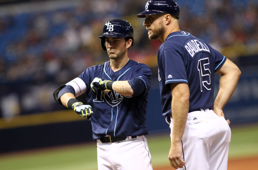 ST. PETERSBURG, FL - JULY 5: Nick Franklin #2 of the Tampa Bay Rays stands next to first base coach Rocco Baldelli #15 as he gestures back to the dugout after hitting a two-run single during the fifth inning of a game against the Los Angeles Angels of Anaheim on July 5, 2016 at Tropicana Field in St. Petersburg, Florida. (Photo by Brian Blanco/Getty Images)