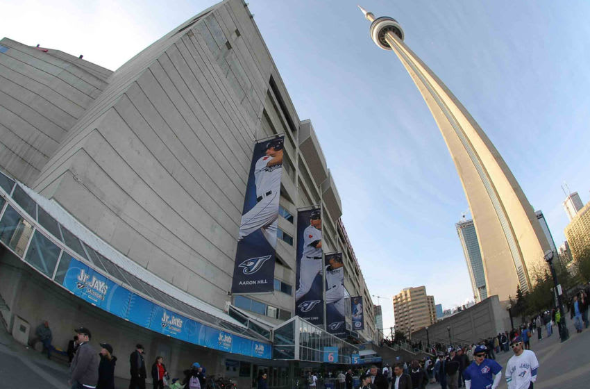 TORONTO - APRIL 12: A view of Rogers Centre and the CN Tower as fans enter for the match between the Chicago White Sox and the Toronto Blue Jays during their MLB game at the Rogers Centre April 12, 2010 in Toronto, Ontario.(Photo By Dave Sandford/Getty Images)