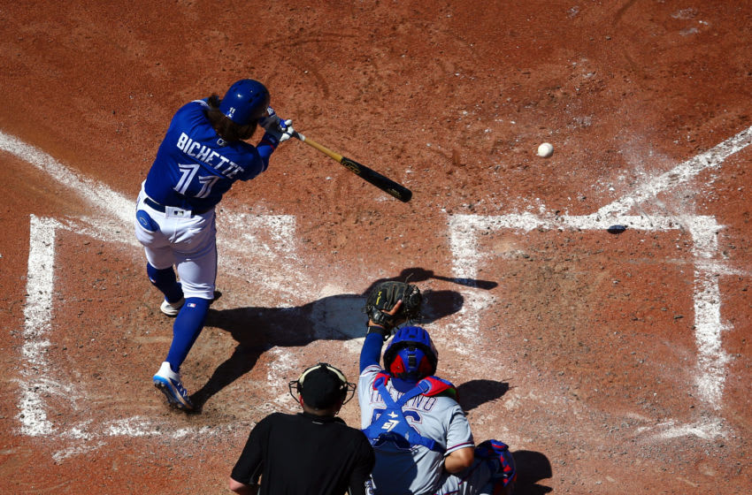 TORONTO, ON - AUGUST 14: Bo Bichette #11 of the Toronto Blue Jays hits a double in the sixth inning during a MLB game against the Texas Rangers at Rogers Centre on August 14, 2019 in Toronto, Canada. (Photo by Vaughn Ridley/Getty Images)