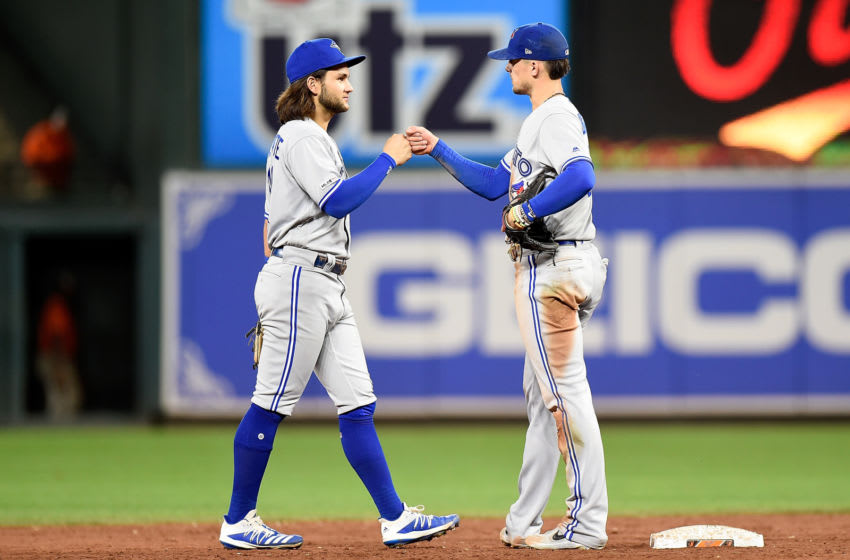 BALTIMORE, MD - SEPTEMBER 17: Cavan Biggio #8 of the Toronto Blue Jays celebrates with Bo Bichette #11 after a 8-5 victory against the Baltimore Orioles at Oriole Park at Camden Yards on September 17, 2019 in Baltimore, Maryland. (Photo by Greg Fiume/Getty Images)