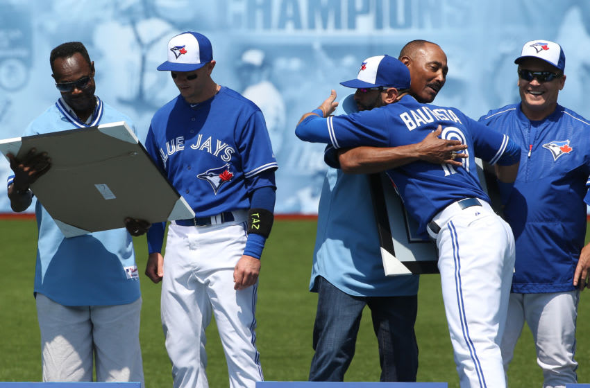 TORONTO, CANADA - AUGUST 16: Former players Tony Fernandez #1 and George Bell #11 of the Toronto Blue Jays are honored in a ceremony commemorating the 30th anniversary of the Blue Jays' first division title as Troy Tulowitzki #2 and Jose Bautista #19 present gifts as manager John Gibbons #5 looks on before the start of MLB game action against the New York Yankees on August 16, 2015 at Rogers Centre in Toronto, Ontario, Canada. (Photo by Tom Szczerbowski/Getty Images)