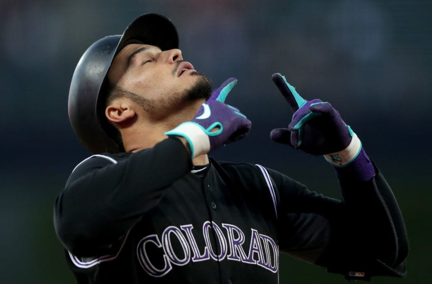 DENVER, COLORADO - SEPTEMBER 13: Nolan Arenado #28 of the Colorado Rockies gestures as he crosses the plate after hitting a 2 RBI home run in the first inning against the San Diego Padres at Coors Field on September 13, 2019 in Denver, Colorado. (Photo by Matthew Stockman/Getty Images)