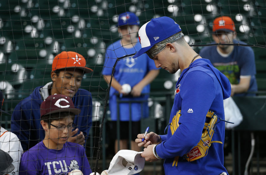 HOUSTON, TEXAS - JUNE 14: Cavan Biggio #8 of the Toronto Blue Jays signs autographs for fans at Minute Maid Park on June 14, 2019 in Houston, Texas. (Photo by Bob Levey/Getty Images)