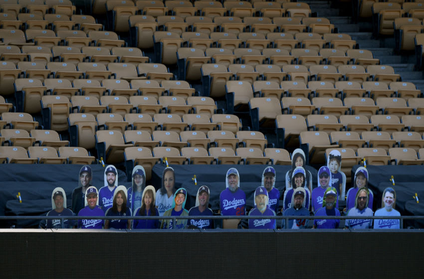 LOS ANGELES, CALIFORNIA - JULY 19: A section of seats behind home plate outfitted with cutouts of fans' faces before a preseason game between the Arizona Diamondbacks and the Los Angeles Dodgers in a preseason game during the coronavirus (COVID-19) pandemic at Dodger Stadium on July 19, 2020 in Los Angeles, California. (Photo by Harry How/Getty Images)
