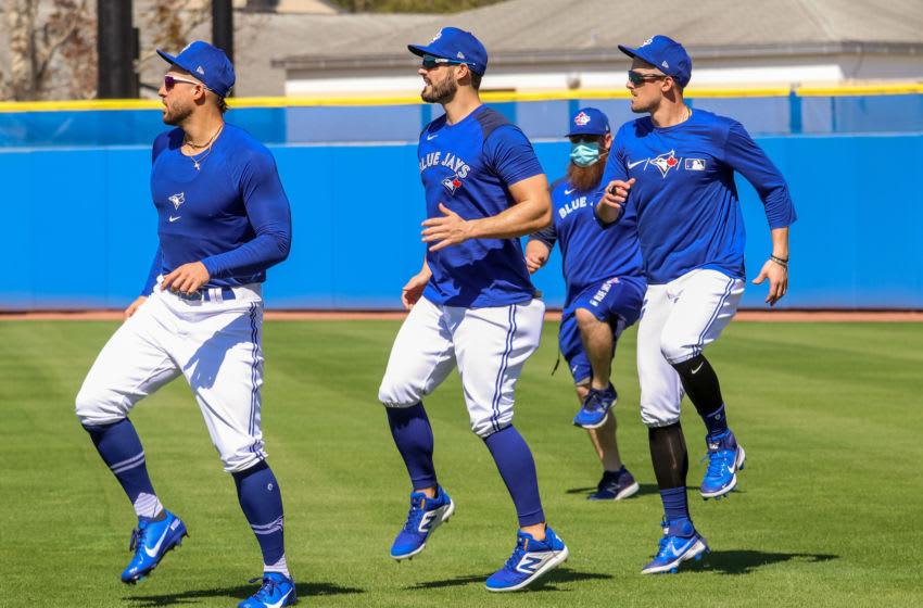 Feb 23, 2021; Dunedin, FL, USA; Toronto Blue Jays players including George Springer (left) warm up during spring training. Mandatory Credit: Toronto Blue Jays/Handout Photo via USA TODAY Sports