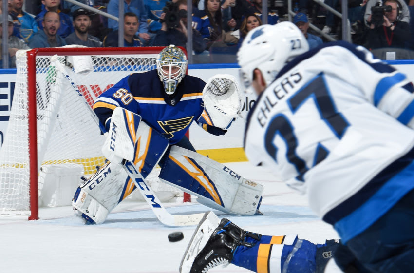ST. LOUIS, MO - APRIL 16: Jordan Binnington #50 of the St. Louis Blues makes a save on a shot from Nikolaj Ehlers #27 of the Winnipeg Jets in Game Four of the Western Conference First Round during the 2019 NHL Stanley Cup Playoffs at Enterprise Center on April 16, 2019 in St. Louis, Missouri. (Photo by Joe Puetz/NHLI via Getty Images)