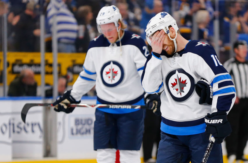 ST. LOUIS, MO - APRIL 20: Bryan Little #18 of the Winnipeg Jets reacts after the Jets were eliminated in Game Six of the Western Conference First Round during the 2019 NHL Stanley Cup Playoffs at the Enterprise Center on April 20, 2019 in St. Louis, Missouri. (Photo by Dilip Vishwanat/Getty Images)