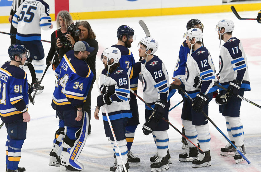 ST. LOUIS, MO - APRIL 20: Players form the traditional handshake line after the Blues won the first round Stanley Cup Playoffs series between the Winnipeg Jets and the St. Louis Blues, on April 20, 2019, at Enterprise Center, St. Louis, Mo. (Photo by Keith Gillett/Icon Sportswire via Getty Images)
