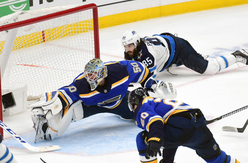 ST. LOUIS, MO - APRIL 20: St. Louis Blues goalie Jordan Binnington (50) blocks a shot during a first round Stanley Cup Playoffs game between the Winnipeg Jets and the St. Louis Blues, on April 20, 2019, at Enterprise Center, St. Louis, Mo. (Photo by Keith Gillett/Icon Sportswire via Getty Images)