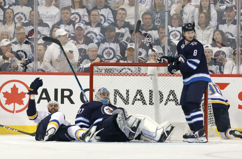 WINNIPEG, MANITOBA - APRIL 12: Robert Bortuzzo #41 of the St. Louis Blues gestures after crashing into Connor Hellebuyck #37 of the Winnipeg Jets in Game Two of the Western Conference First Round during the 2019 NHL Stanley Cup Playoffs at Bell MTS Place on April 12, 2019 in Winnipeg, Manitoba, Canada. (Photo by Jason Halstead/Getty Images)