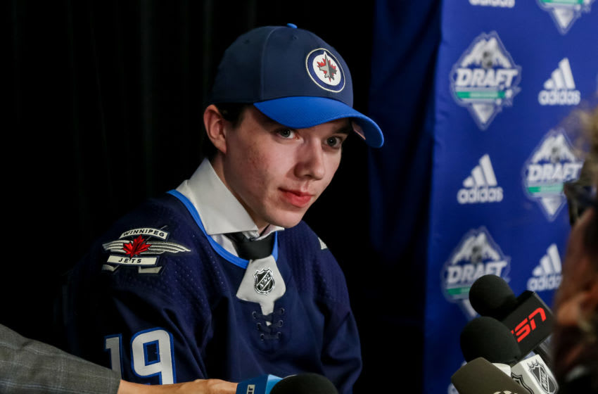 VANCOUVER, BC - JUNE 21: Ville Heinola speaks with the media after being selected twentieth overall by the Winnipeg Jets during the first round of the 2019 NHL Draft at Rogers Arena on June 21, 2019 in Vancouver, British Columbia, Canada. (Photo by Jonathan Kozub/NHLI via Getty Images)