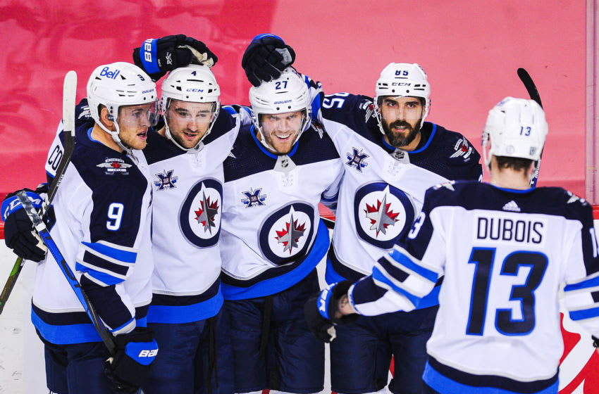 CALGARY, AB - FEBRUARY 9: Nikolaj Ehlers #27 (C) of the Winnipeg Jets celebrates with his teammates after scoring a goal against the Calgary Flames during an NHL game at Scotiabank Saddledome on February 9, 2021 in Calgary, Alberta, Canada. (Photo by Derek Leung/Getty Images)