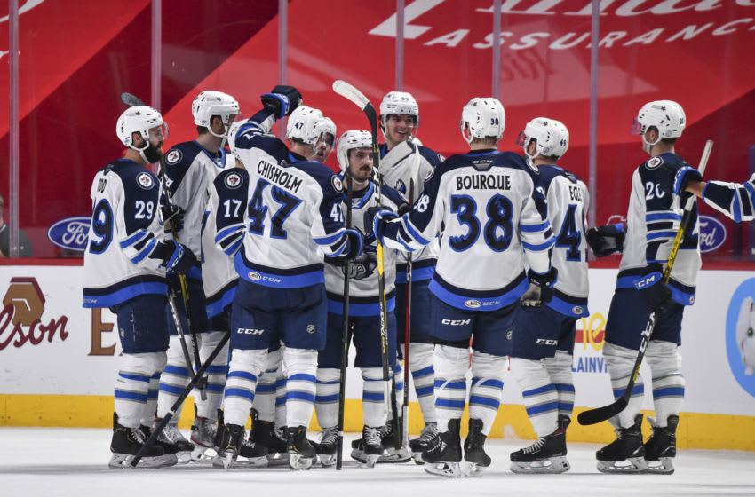 MONTREAL, QC - FEBRUARY 22: The Manitoba Moose celebrate their overtime victory against the Laval Rocket at the Bell Centre on February 22, 2021 in Montreal, Canada. The Manitoba Moose defeated the Laval Rocket 3-2 in overtime. (Photo by Minas Panagiotakis/Getty Images)