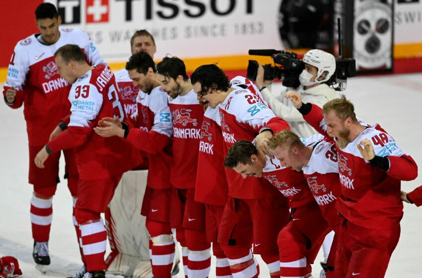 Denmark's players celebrate at the end of the IIHF Men's Ice Hockey World Championships preliminary round Group A match between Denmark and Belarus at the Olympic Sports Center in Riga, on May 28, 2021. - Denmark won the match 5-2. (Photo by Gints IVUSKANS / AFP) (Photo by GINTS IVUSKANS/AFP via Getty Images)