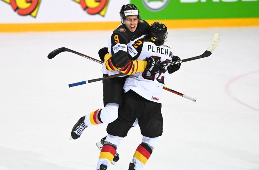 Germany's defender Leon Gawanke (L) celebrates scoring the 2-2 equaliser with Germany's forward Matthias Plachta during the IIHF Men's Ice Hockey World Championships quarter final match between Switzerland and Germany, at the Olympic Sports Center in Riga, Latvia, on June 3, 2021. (Photo by Gints IVUSKANS / AFP) (Photo by GINTS IVUSKANS/AFP via Getty Images)